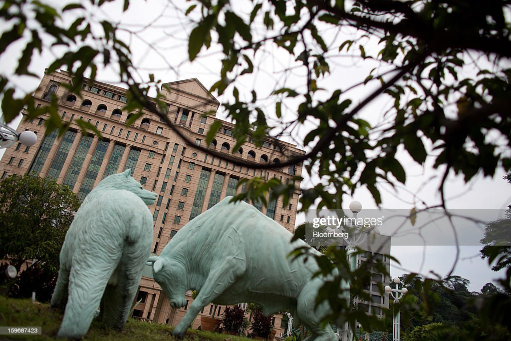 Bear and bull statues stand outside the Bursa Malaysia Bhd. headquarters in Kuala Lumpur, Malaysia, on Wednesday, Jan. 16, 2013. While many developed countries have faltered, Malaysia's gross domestic product growth has exceeded 5 percent for five quarters with domestic demand countering a slowdown in exports. Photographer: Lam Yik Fei/Bloomberg via Getty Images