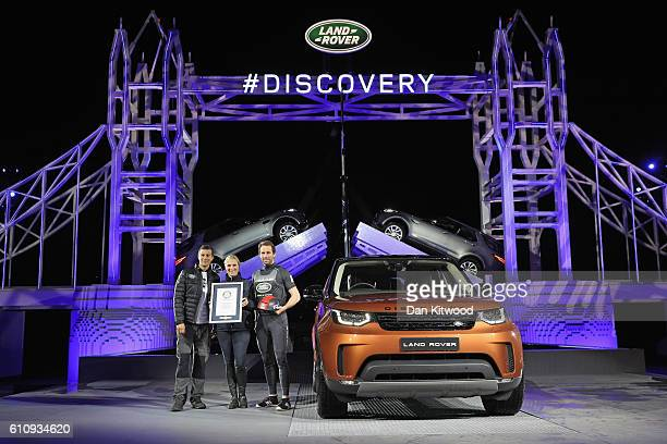 Bear Grylls Zara Phillips and Sir Ben Ainslie pose with a certificate to recognise the official Guinness World Record for the Number of Lego pieces...