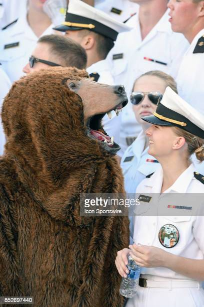 A bear mascot from one of the companies is in the stands with a cadet on September 23 at Navy Marine Corps Memorial Stadium in Annapolis MD The Navy...