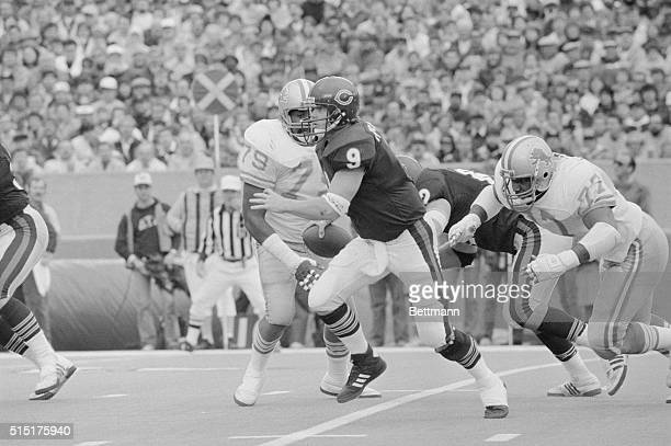 Bear quarterback Jim McMahon tries to run away from Lions' Keith Ferguson but is sacked for a short loss in the third quarter of game Other Lion...