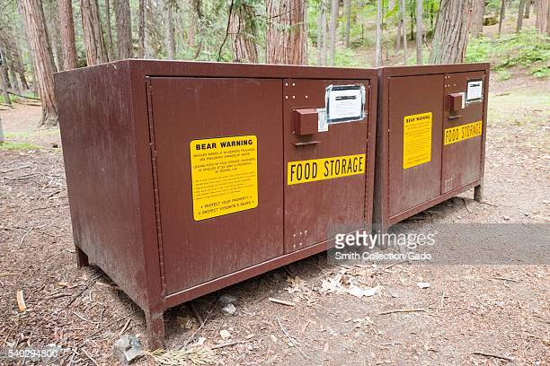 Bear safe food storage lockers for campers in Yosemite National Park with signs warning campers not to leave food in their cars Yosemite Valley...