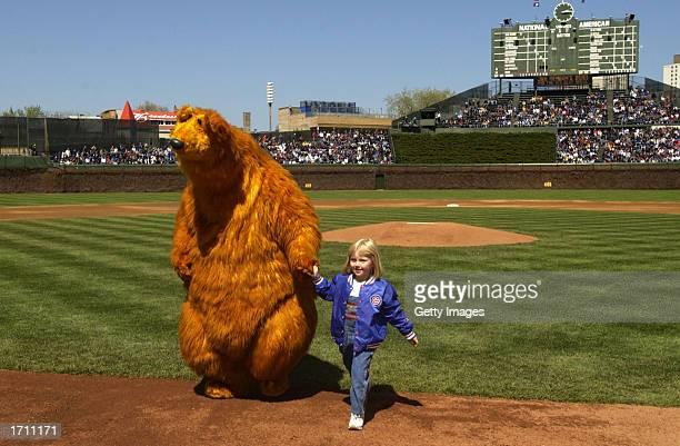 Bear the star of 'Jim Henson's Bear in the Big Blue House' gets a a little help from Jillian Lieber daughter of Chicago Cubs pitcher Jon Lieber after...