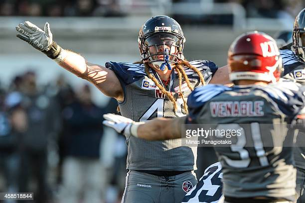 Bear Woods of the Montreal Alouettes reacts after a tackle during the CFL game against the Toronto Argonauts at Percival Molson Stadium on November 2...