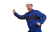 Beard man builder in hard hat and overalls runs for construction isolated on the white background.