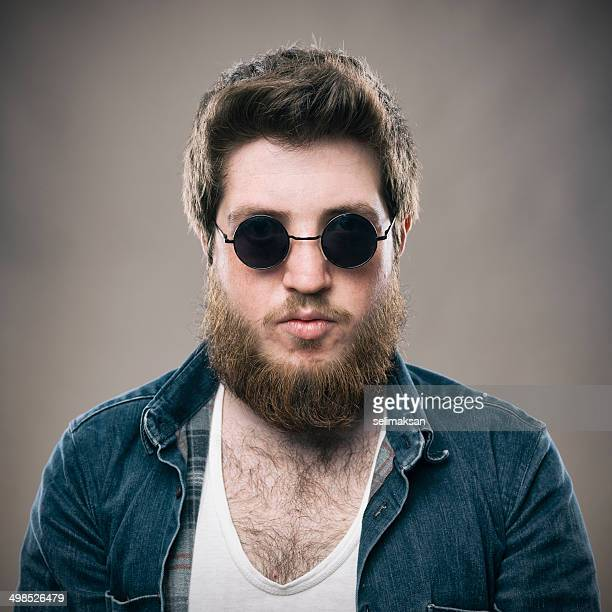 Bearded adult man with sun glasses