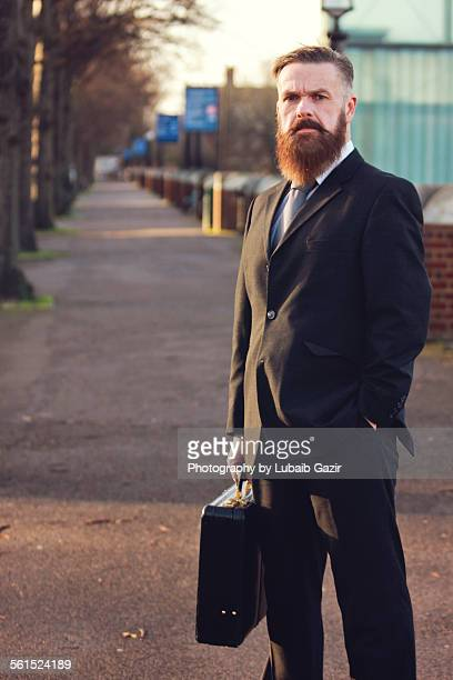 Bearded businessman holding his briefcase