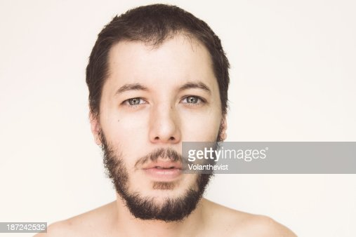 Bearded handsome young man w/ blue eyes : Stock Photo