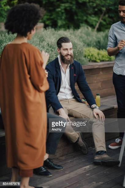Bearded hipster relaxing with colleagues during break time