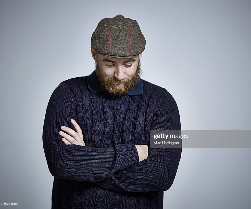 Bearded Male with navy sweater and flat cap