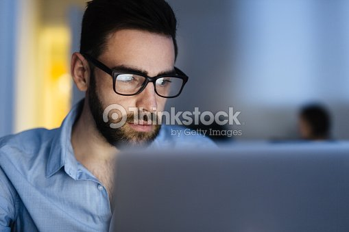Bearded Man Busy Working Late : Stock Photo