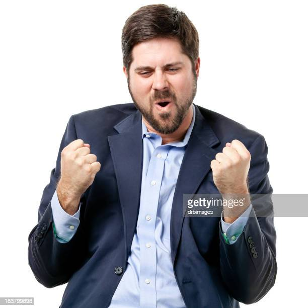 Bearded man in a suit doing the fist pump