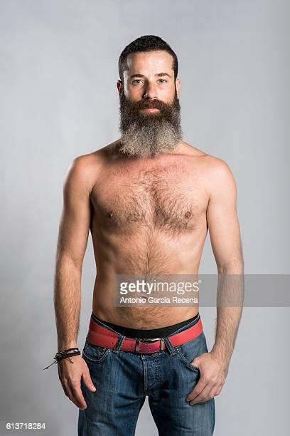 Bearded man in jeans