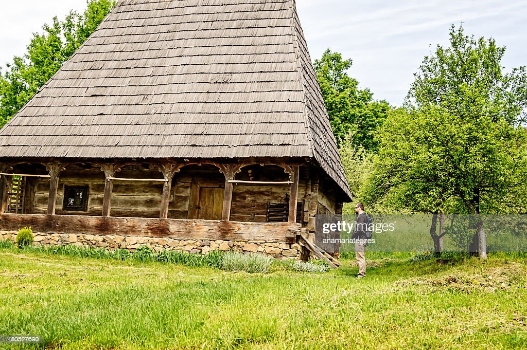 Bearded Man Looking at an Old House : Stock Photo