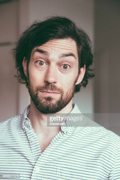 Bearded man looking at camera with a surprised expression