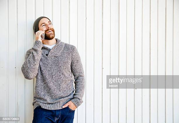 Bearded Man on Mobile Phone