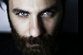 İstanbul, Turkey - February 23. 2017:close up face, blue eyes, strong man, bearded man