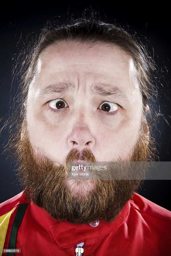 Bearded man puckering his mouth