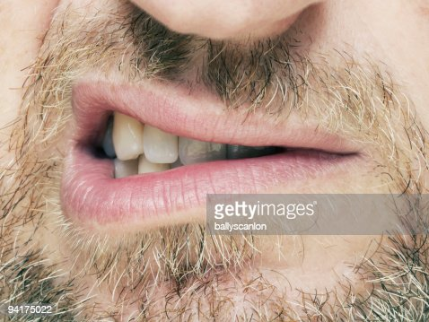 Bearded man snarling.