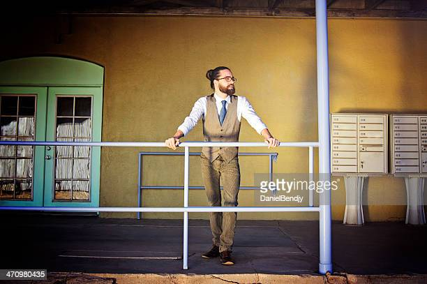 Bearded Man Standing In Front of His Business