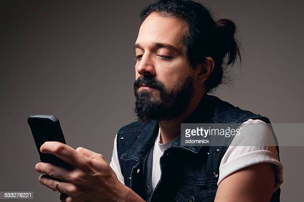 Bearded Man Texting
