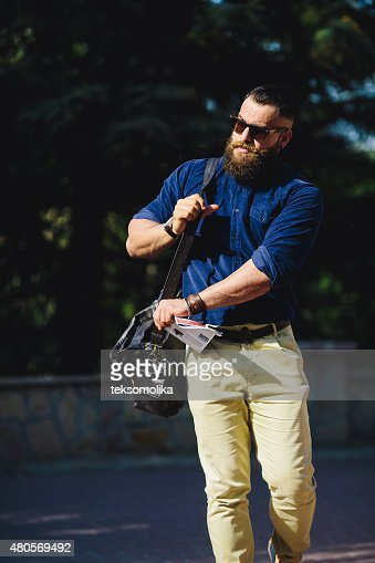 bearded man walks through the city : Stock Photo