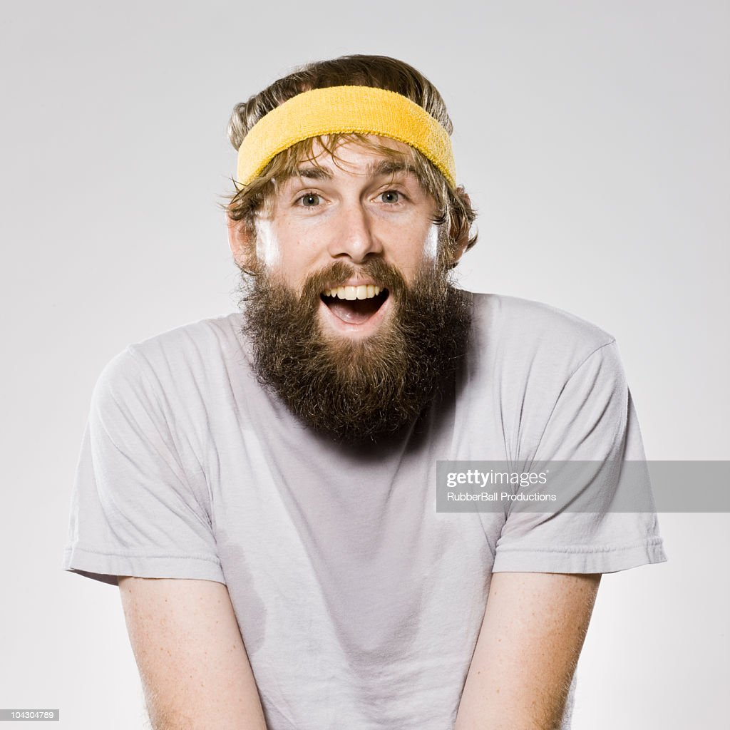 bearded man wearing a headband : Stock Photo