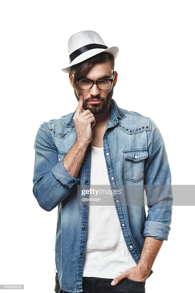 Bearded man with a hat posing in the studio : Stock Photo