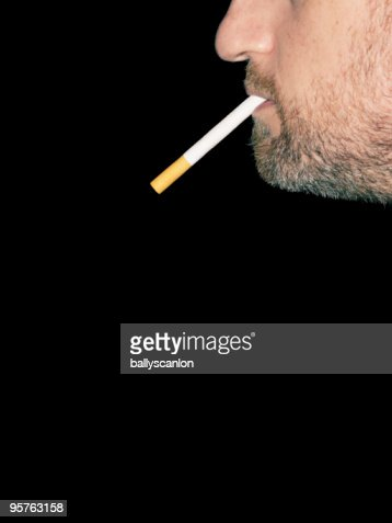 Bearded Man With Cigarette Back to Front. : Stock Photo