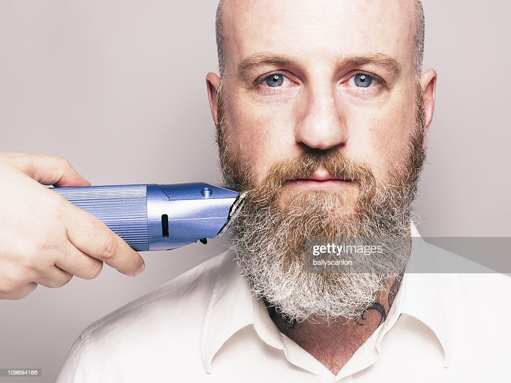 Bearded Man With Hair Clippers.  Portrait. : Stock Photo