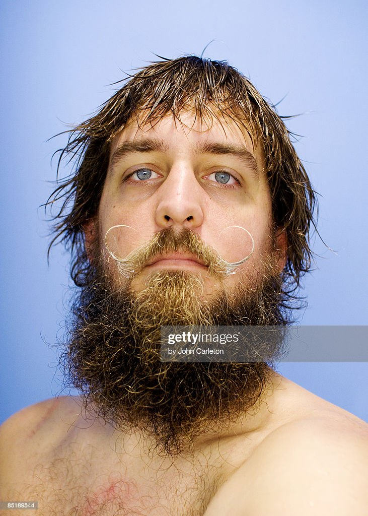 Bearded man with handlebar moustache : Stock Photo