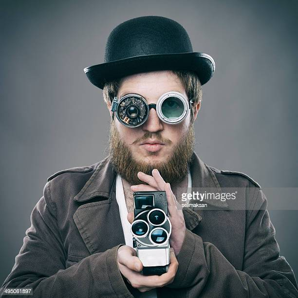 Bearded man with his old fashioned smart glasses holding camera