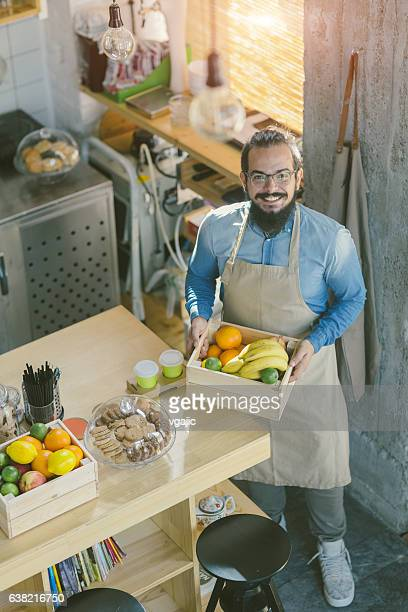 Bearded Man Working In His Cafe
