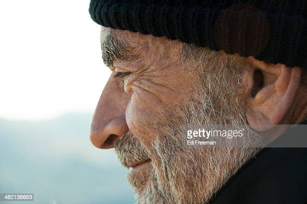 Bearded Old Man in Cap Smiling