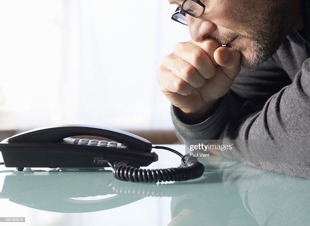 beared man waiting by phone : Stock Photo