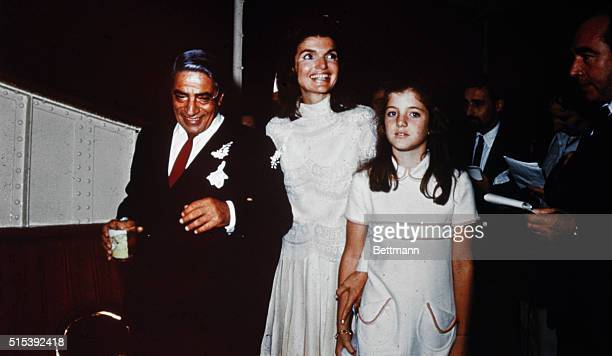 Bearing traces of confetti Mr and Mrs Aristotle Onassis are shown at their October 20th wedding on Onassis' private island Caroline Kennedy stands...