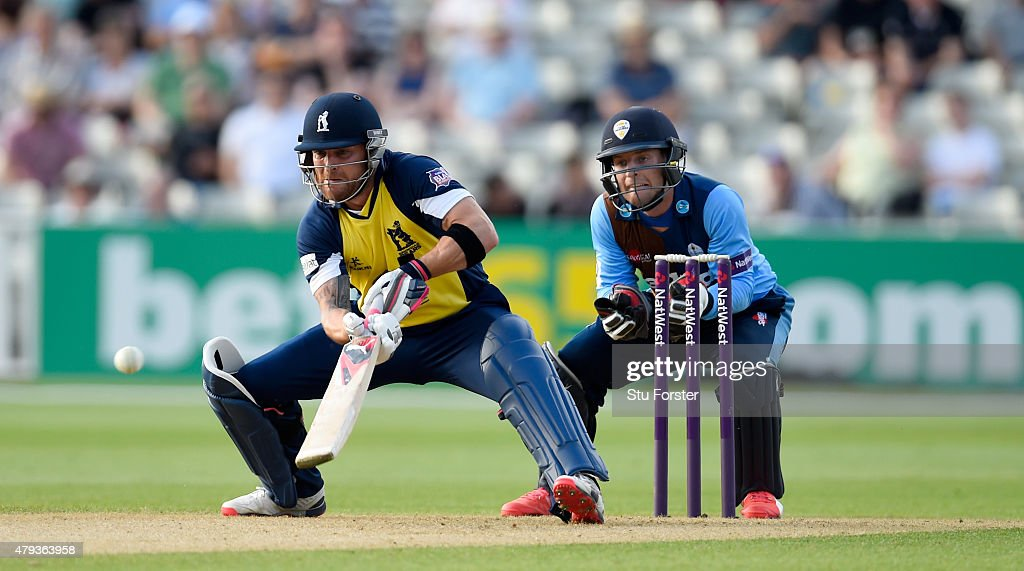 Bears batsman Brendon McCullum plays a paddle shot to the boundary watched by Falcons keeper Tom Poynton during the NatWest T20 Blast match between...