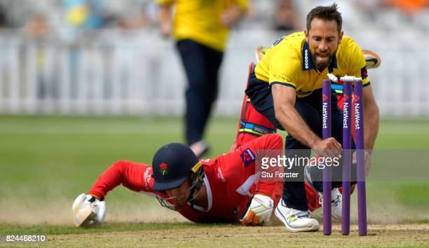 Bears bowler Grant Elliott narrowly misses running out Lancashire batsman Jos Buttler during the Natwest T20 Blast match between Birmingham Bears and...