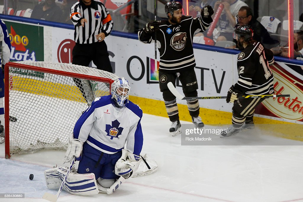 Bears celebrate the 3rd goal as Toronto Marlies goalie Antoine Bibeau (1) reacts. Toronto Marlies V Hersey Bears during 2nd period play of Game 5 of AHL playoff action at the Ricoh Coliseum. Hersey leads the series 3-1. Toronto Star/Rick Madonik