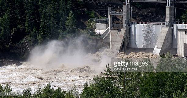 Bearspaw Dam opens the gates releasing water into the flooded Bow River in Calgary Alberta Canada June 22 2013 AFP PHOTO/DAVE BUSTON