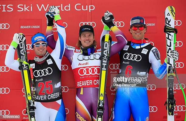 Beat Feuz of Switzerland in second place Kjetil Jansrud of Norway in first place and Steven Nyman of the United States in third place celebrate on...