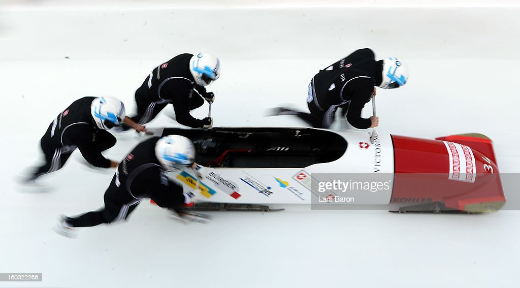 Beat Hefti, Alex Baumann, Thomas Lamparter and Juerg Egger of Switzerland compete during a training session at Olympia Bob Run on January 29, 2013 in St Moritz, Switzerland.