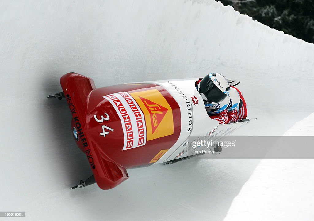 Beat Hefti, Alex Baumann, Thomas Lamparter and Juerg Egger of Switzerland compete during the Four Men Bobsleigh heat one of the IBSF Bob & Skeleton World Championship at Olympia Bob Run on February 2, 2013 in St Moritz, Switzerland.