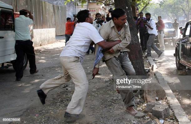Beat Outsiders Violence MNS workers thrash a Taxi driver at Shivaji Park on Monday