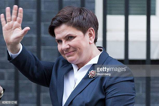 Beata Szydlo Poland's prime minister waves as she arrives to meet UK Prime Minister Theresa May in Downing Street in London UK on Monday Nov 28 2016...