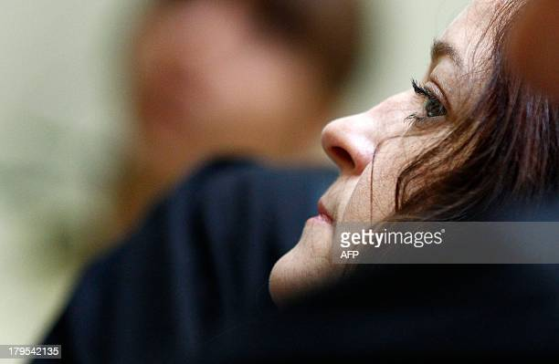 Beate Zschaepe accused of being at the heart of neoNazi killer cell NSU arrives for the continuation of her trial on September 5 2013 at the regional...