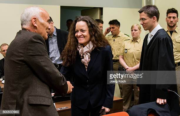 Beate Zschaepe the main defendant in the NSU neoNazi murder trial greets her lawyers Hermann Borchert and Mathias Grasel for day 249 of the trial at...