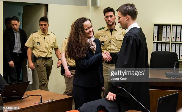 Beate Zschaepe the main defendant in the NSU neoNazi murder trial greets her lawyer Mathias Grasel while codefandant Ralf Wohlleben arrives for day...