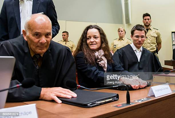 Beate Zschaepe the main defendant in the NSU neoNazi murder trial sits with her lawyers Mathias Grasel and Hermann Borchert and waits for day 249 of...