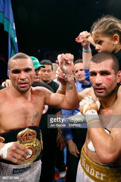 Beaten challenger Nader Hamdan raises the fist of champion Anthony Mundine after the fight