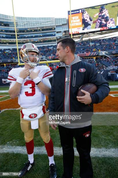 J Beathard and Head Coach Kyle Shanahan of the San Francisco 49ers talk on the field prior to the game against the Chicago Bears at Soldier Field on...